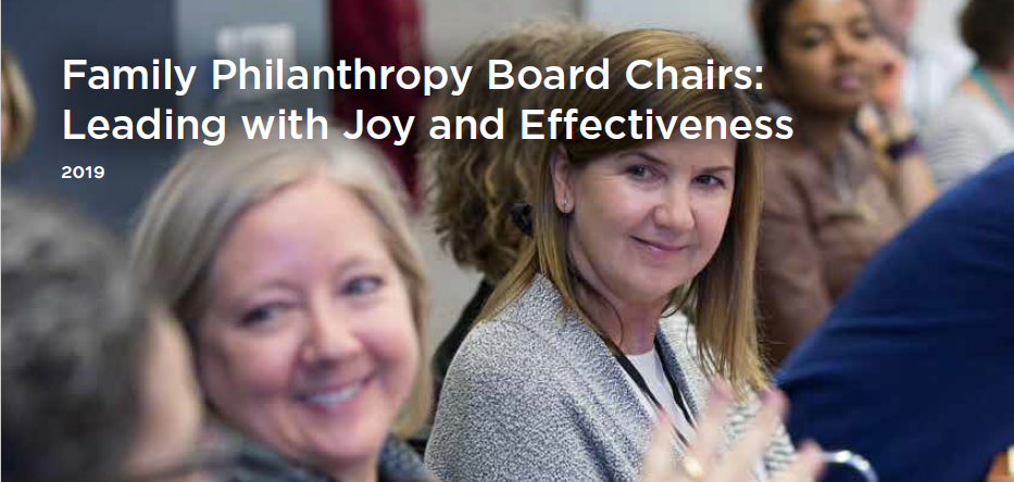 Two white women sit at a table, looking off camera to illustrate the Passages issue brief on Board Chairs
