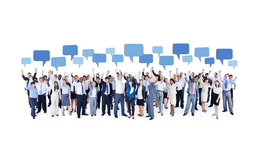 a group of business people with idea bubbles hovering above them