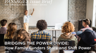 Cover of the Passages Issue Brief, Bridging the Power Divide, with a person teaching a few others in a room
