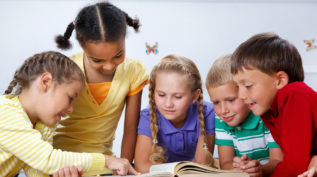 a group of children reads together