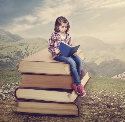 a girl reads a book while sitting on a stack of books