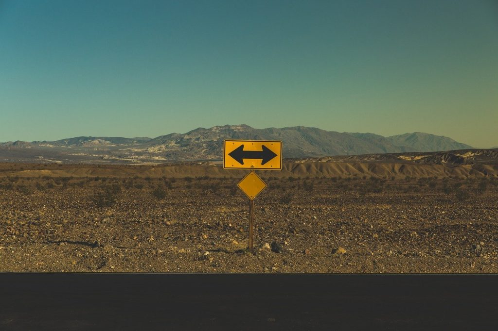 Arrow pointing both directions in desert