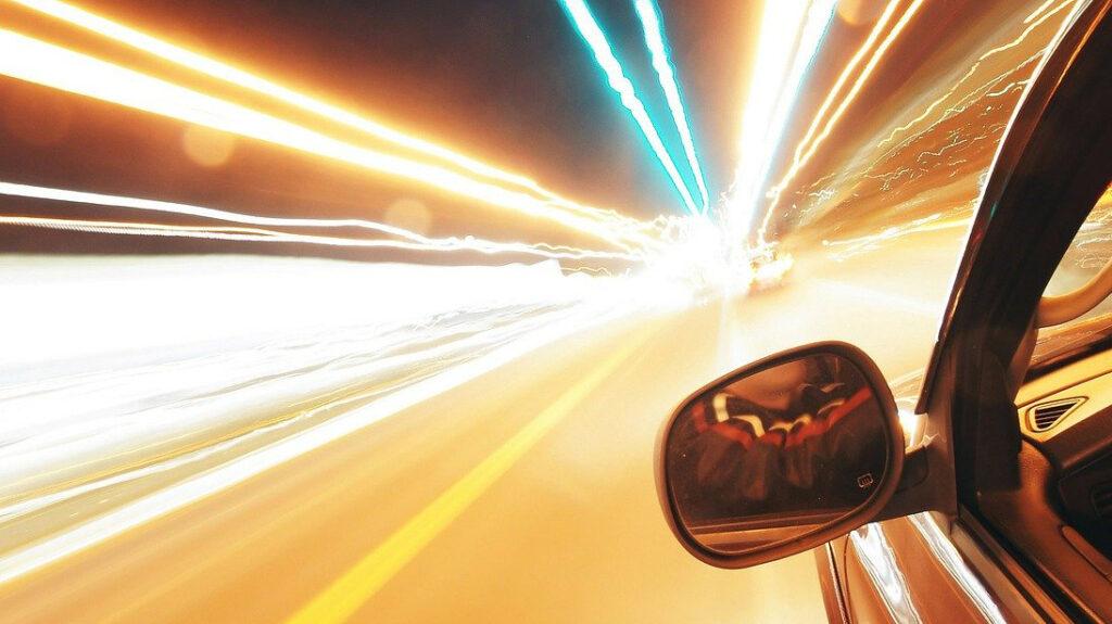 car accelerating through tunnel
