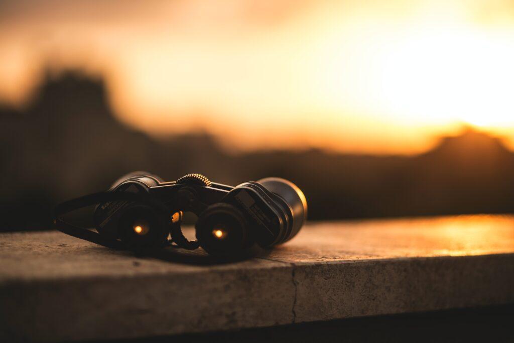 binoculars looking into distance