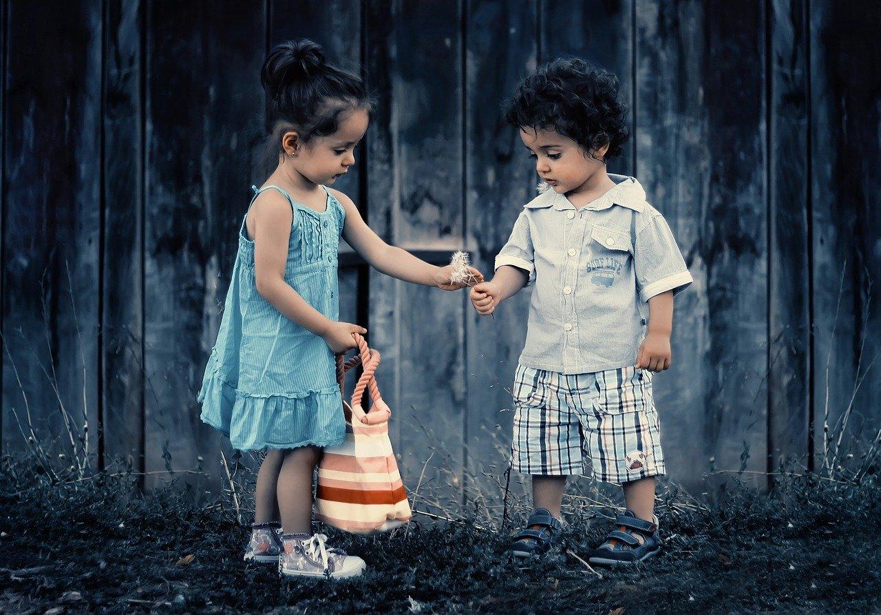 children sharing dandelions