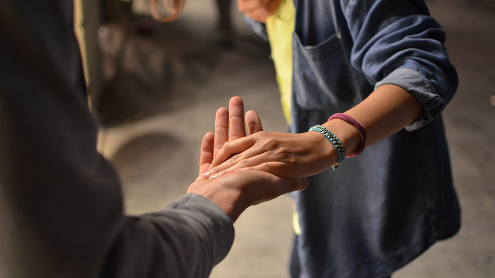 hands reaching out to each other, helping