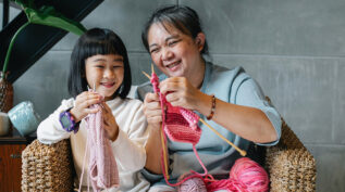 young child and grandmother knitting - engaging the next generation