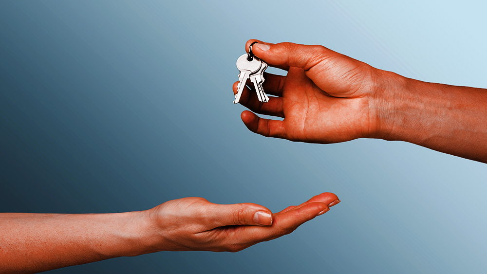 hand giving set of keys to another hand - succession, passing the baton, transition