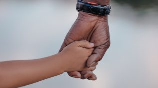 Adult hand holding child's hand - legacy